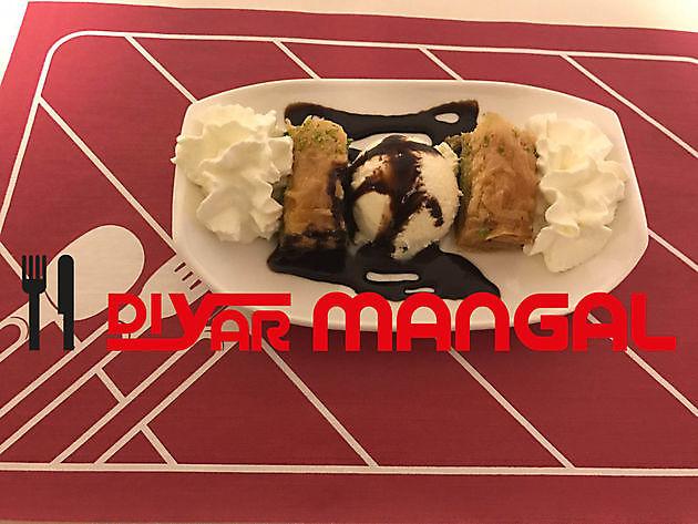 Sluit uw gerecht geheel in Turkse stijl af - Diyar Mangal Houtskoolrestaurant